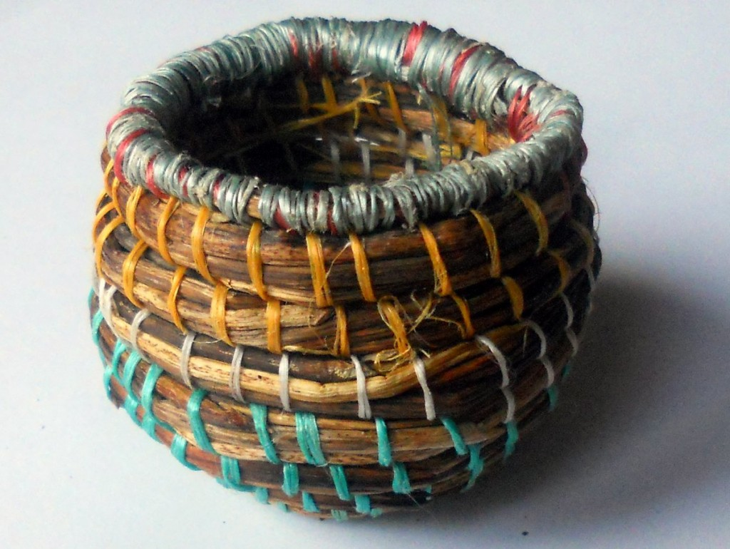 Basket made from coiled sycamore leaf stems and strands of rope found on beach
